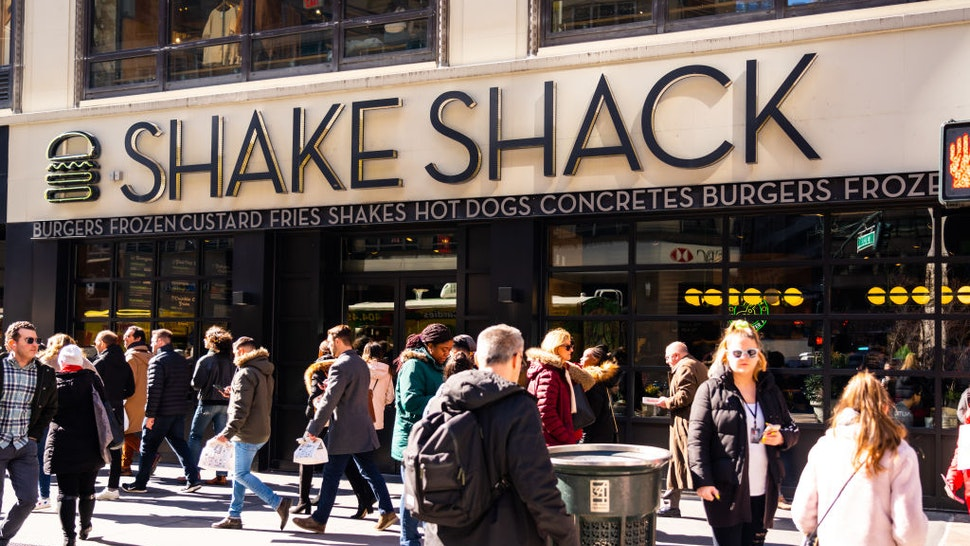 NEW YORK CITY, UNITED STATES - 2020/02/20: Pedestrians walk past an American fast casual restaurant chain, Shake Shack store in New York City. (Photo Illustration by Alex Tai/SOPA Images/LightRocket via Getty Images)