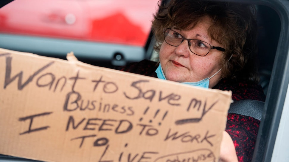 UNITED STATES - APRIL 18: Dolores Garrity, 61, a hair salon owner, demands that Gov. Larry Hogan (R) lift restrictions that have closed certain businesses in Maryland since the coronavirus outbreak on Church Circle in Annapolis, Md., on Saturday, April 18, 2020. The event titled Operation Gridlock Annapolis was hosted by the Patriot Picket and Reopen Maryland. (Photo By Tom Williams/CQ-Roll Call, Inc via Getty Images)