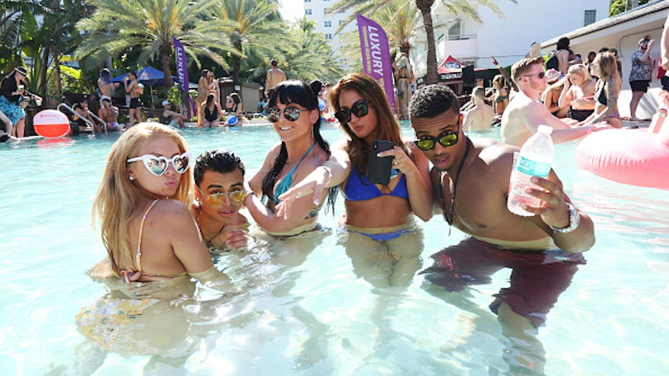MIAMI BEACH, FLORIDA - MARCH 22: Students on Spring Break attend the MK Area 10 Party hosted by 93.5FM Revolution Radio Miami at the National Hotel on South Beach as part of Miami Music Week on March 22, 2018 in Miami Beach, Florida.