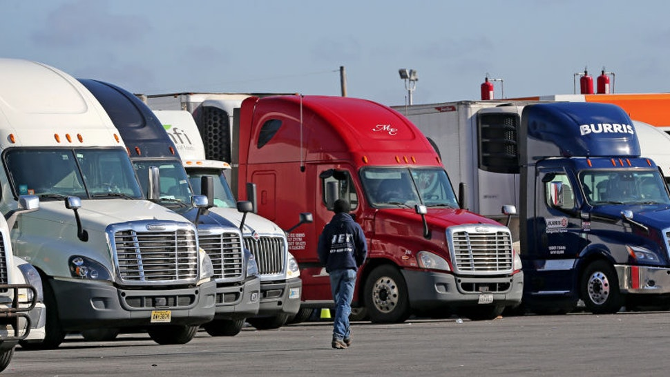 Truck drivers take a rest at the Westborough Service Plaza in Westborough, MA along the Massachusetts Turnpike on March 26, 2020. Even as the COVID-19 pandemic has forced a majority of people to work from home, most of the nations 3.5 million drivers have kept rolling, trying to mitigate unprecedented supply chain disruptions by continuing to move goods around the nation. (Photo by David L. Ryan/The Boston Globe via Getty Images)