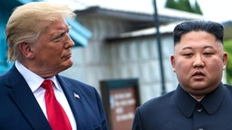 US President Donald Trump and North Korea's leader Kim Jong-un talk before a meeting in the Demilitarized Zone (DMZ) on June 30, 2019, in Panmunjom, Korea.