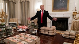 WASHINGTON, DC - JANUARY 14: (AFP OUT) U.S President Donald Trump presents fast food to be served to the Clemson Tigers football team to celebrate their Championship at the White House on January 14, 2019 in Washington, DC.