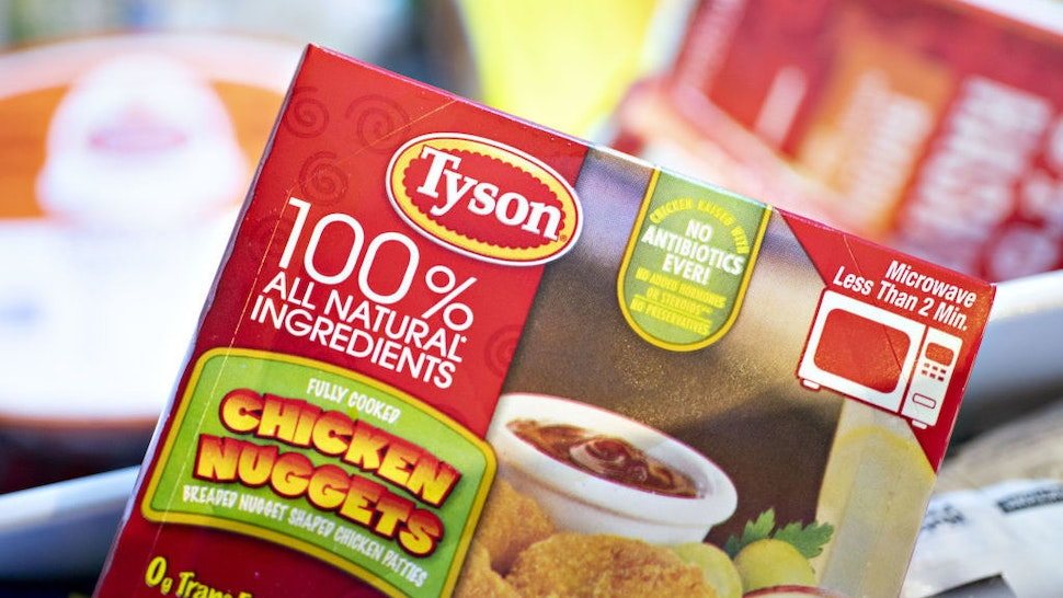 A package of Tyson Foods Inc. brand chicken nuggets is arranged for a photograph in Tiskilwa, Illinois, U.S., on Monday, Aug. 6, 2018. The largest U.S. meat company posted better-than-expected fiscal third-quarter earnings as beef demand rose and cattle costs fell, Tyson said Monday in astatement. Photographer: Daniel Acker/Bloomberg