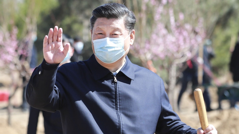 BEIJING, April 3, 2020 -- Chinese President Xi Jinping, also general secretary of the Communist Party of China Central Committee and chairman of the Central Military Commission, waves to the officials and people on-site during a voluntary tree-planting activity in Daxing District in Beijing, capital of China, April 3, 2020. The activity was also attended by other leaders including Li Keqiang, Li Zhanshu, Wang Yang, Wang Huning, Zhao Leji, Han Zheng and Wang Qishan.