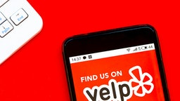 UKRAINE - 2020/04/07: In this photo illustration a Yelp logo seen displayed on a smartphone.