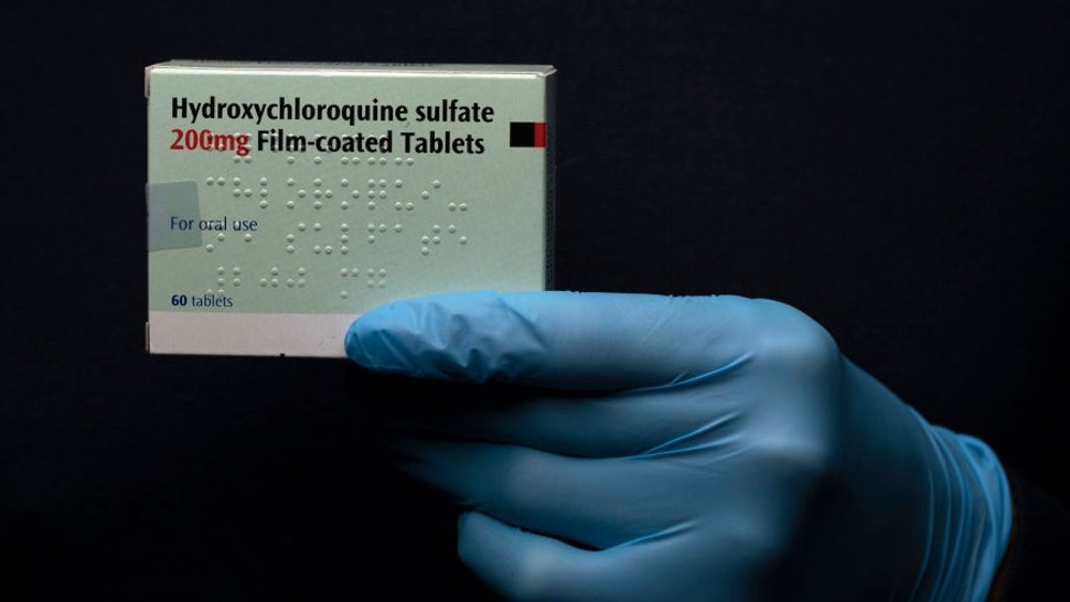 """In this photo illustration a pack of Hydroxychloroquine Sulfate medication is held up on March 26, 2020 in London, United Kingdom. The Coronavirus (COVID-19) pandemic has spread to many countries across the world, claiming over 20,000 lives and infecting hundreds of thousands more. U.S. President Donald Trump recently promoted Hydroxychloroquine, a common anti-malaria drug, as a potential treatment for COVID-19 when combined with the antibiotic azithromycin. """"HYDROXYCHLOROQUINE & AZITHROMYCIN, taken together, have a real chance to be one of the biggest game changers in the history of medicine,"""" President Trump tweeted last week. (Photo by"""