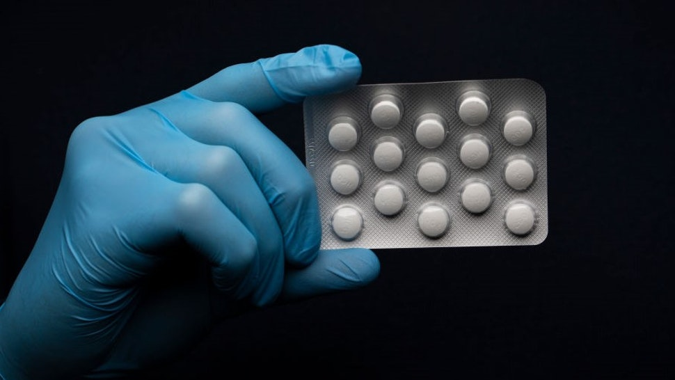 """LONDON, UNITED KINGDOM - MARCH 26: In this photo illustration a pack of Hydroxychloroquine Sulfate medication is held up on March 26, 2020 in London, United Kingdom. The Coronavirus (COVID-19) pandemic has spread to many countries across the world, claiming over 20,000 lives and infecting hundreds of thousands more. U.S. President Donald Trump recently promoted Hydroxychloroquine, a common anti-malaria drug, as a potential treatment for COVID-19 when combined with the antibiotic azithromycin. """"HYDROXYCHLOROQUINE & AZITHROMYCIN, taken together, have a real chance to be one of the biggest game changers in the history of medicine,"""" President Trump tweeted last week. (Photo by"""