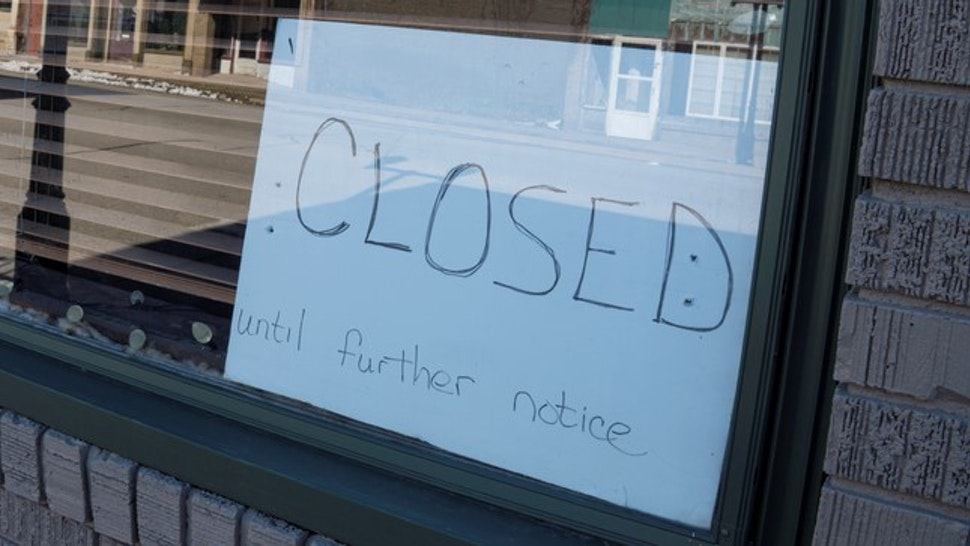 Closed Until Further Notice Sign in Small Business Window