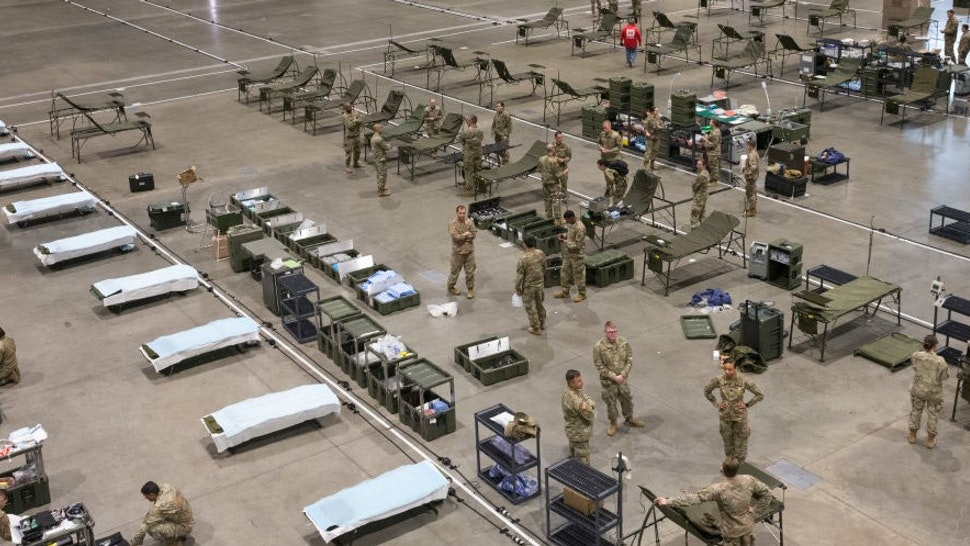 Military personnel set up the 627th Hospital Center field hospital at CenturyLink Event Center on March 31, 2020 in Seattle, Washington. 250 beds, including 148 from Fort Carson, Colorado, and other personnel from Joint Base Lewis-McChord, will be ready for non-COVID-19 patients sometime next week. When done it will have the capability of a normal hospital including an operating room, intensive care units, X-rays and more. (Photo by