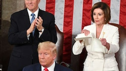 TOPSHOT - Speaker of the US House of Representatives Nancy Pelosi rips a copy of US President Donald Trumps speech after he delivered the State of the Union address at the US Capitol in Washington, DC, on February 4, 2020. (Photo by MANDEL NGAN / AFP) (Photo by