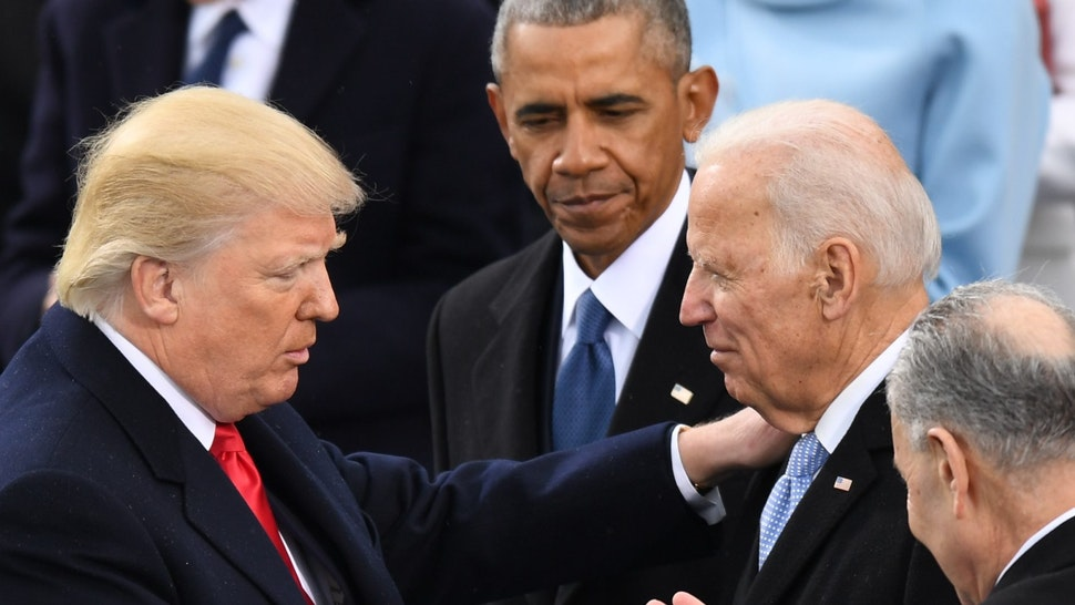 WASHINGTON, DC - JANUARY 20: President Donald J. Trump shakes hands with Former vice president Joe Biden as Former president Barack Obama looks on at the inauguration of President Donald J. Trump on January 20, 2017. (Photo by