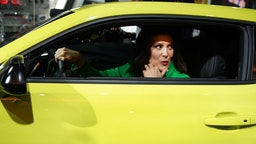 Gretchen Whitmer, newley elected governor of Michigan, sits in a Chevrolet Camaro as she tours the show during day two of the 2019 The North American International Auto Show on January 15, 2019 at the Cobo Center in Detroit, Michigan. (Photo by TIMOTHY A. CLARY / AFP) (Photo credit should read