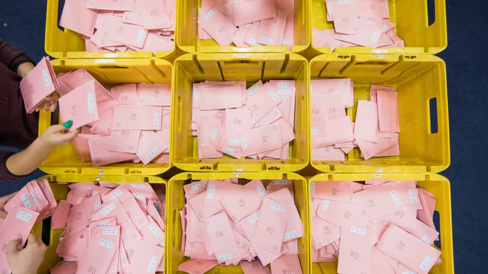 Election helpers sort postal ballots for the federal election into boxes in Cologne, Germany, 14 September 2017.