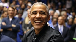 Former President of the United States, Barack Obama, watches on during the game between the North Carolina Tar Heels and Duke Blue Devils at Cameron Indoor Stadium on February 20, 2019 in Durham, North Carolina.