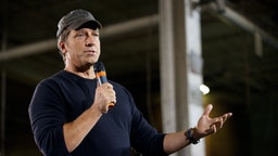 """TV personality Mike Rowe , host of """"Dirty Jobs"""", takes part in a roundtable discussion on manufacturing with Republican presidential candidate Mitt RomneySeptember 26, 2012 American Spring Wire in Bedford Heights, Ohio."""