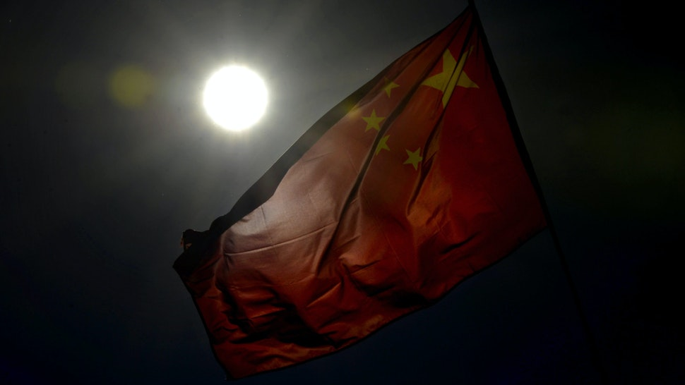 A Chinese flag is displayed at the Great Hall of the People, the site of the Communist Party Congress in Beijing on November 13, 2012.
