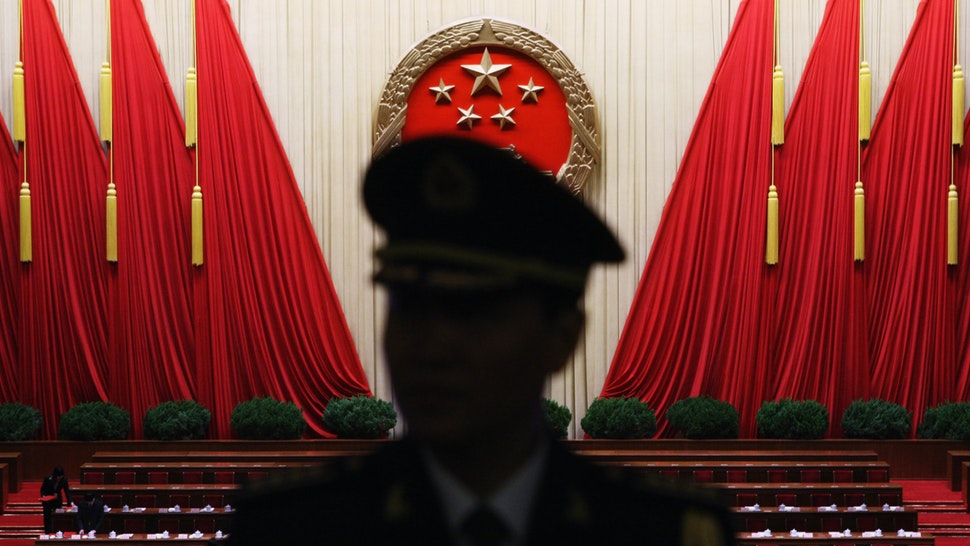 A Chinese military band conductor is seen during a rehearsal before the closing session of the National People's Congress (NPC), or parliament, at the Great Hall of the People on March 13, 2009 in Beijing, China.