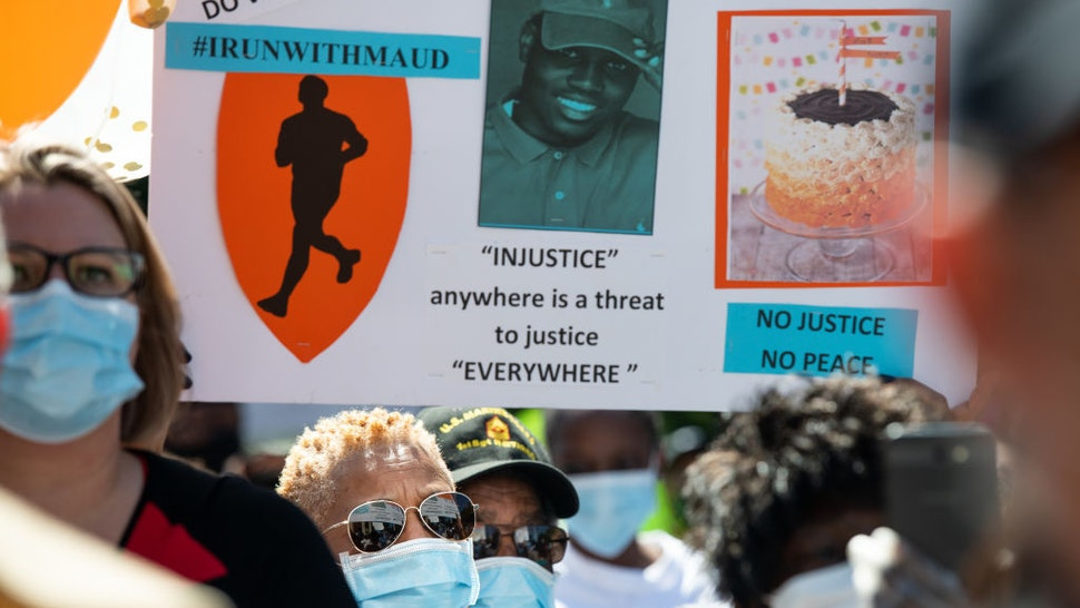Demonstrators protest the shooting death of Ahmaud Arbery at the Glynn County Courthouse on May 8, 2020 in Brunswick, Georgia. Gregory McMichael and Travis McMichael were arrested the previous night and charged with murder. (Photo by Sean Rayford/Getty Images)