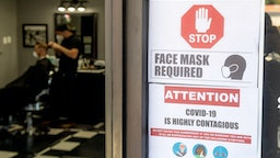 """LAGUNA HILLS, CA - MAY 05: Customers maintain safety protocols at The BarberHood in Laguna Hills, CA, on Tuesday, May 5, 2020. The shop is one of the first to re-open and defy the state""""u2019s stay-at-home order during the COVID-19 (coronavirus) lockdown."""
