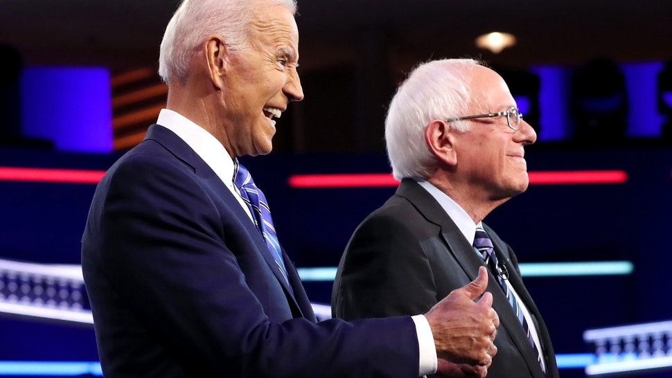 MIAMI, FLORIDA - JUNE 27: former Vice President Joe Biden and Sen. Bernie Sanders (I-VT) take the stage for the second night of the first Democratic presidential debate on June 27, 2019 in Miami, Florida. A field of 20 Democratic presidential candidates was split into two groups of 10 for the first debate of the 2020 election, taking place over two nights at Knight Concert Hall of the Adrienne Arsht Center for the Performing Arts of Miami-Dade County, hosted by NBC News, MSNBC, and Telemundo.