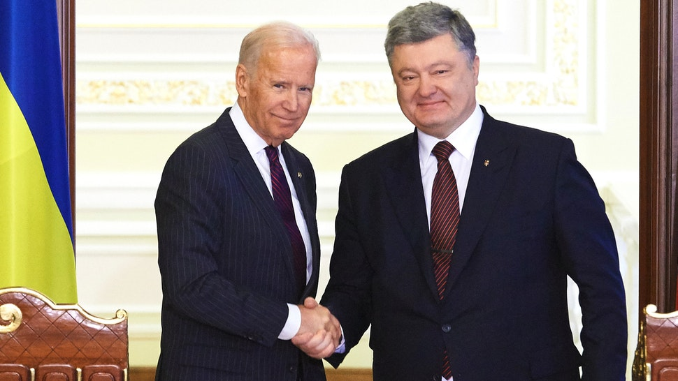 KYIV, UKRAINE - JANUARY 16: Ukrainian President Petro Poroshenko (R) and US Vice President Joe Biden (L) shake hands during a press conference to discuss the outcome of official talks in Kyiv, Ukraine, 16 January 2017. Biden is in Ukraine for a brief visit to meet with Ukrainian President Petro Poroshenko and Prime Minister Volodymyr Groysman.