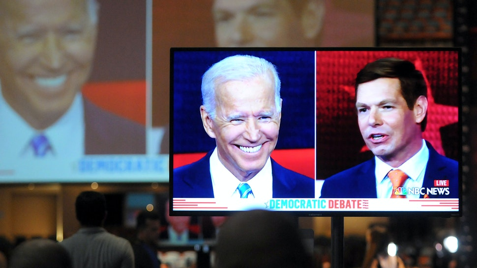Democratic presidential hopeful Rep. Eric Swalwell of California is seen on a monitor in the spin room with former U.S. Vice President Joe Biden during night two of the first Democratic presidential primary debate for the 2020 election on June 27, 2019 at the Knight Concert Hall at the Adrienne Arsht Center for the Performing Arts in Miami, Florida.
