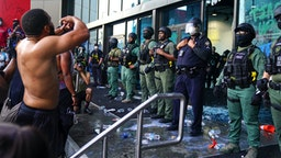 ATLANTA, GA - MAY 29: Police officers guard CNN Center during a protest on May 29, 2020 in Atlanta, Georgia. Demonstrations are being held across the U.S. after George Floyd died in police custody on May 25th in Minneapolis, Minnesota.