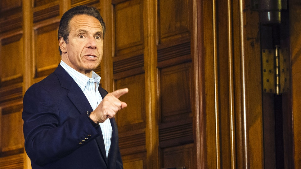 Andrew Cuomo, governor of New York, gestures as he leaves a news conference in the Red Room of the New York State Capitol Building in Albany, New York, U.S., on Sunday, May 17, 2020. Cuomo pleaded on Sunday for more New Yorkers to get tested for the coronavirus as the state reopens for business, engaging in a bit of political theater as he underwent a nasal swab test himself at his daily briefing