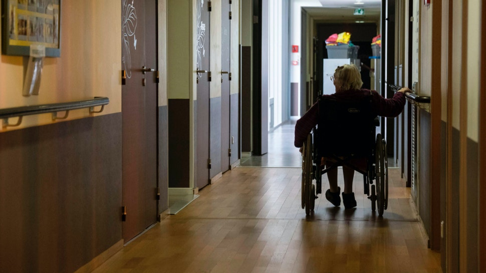 A resident of the Les Flaxinelles EHPAD (Housing Establishment for Dependant Elderly People) in Bergheim, eastern France, rides her wheelchair on April 14, 2020 during the 29th day of a strict confinement in France aimed at curbing the COVID-19 disease caused by the novel coronavirus.