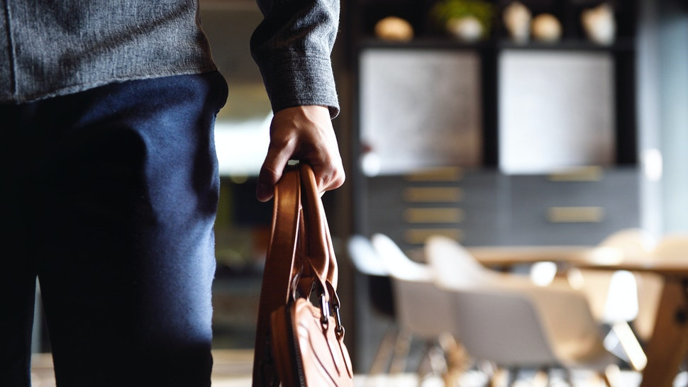 Man holding bag.