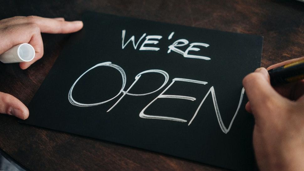 Hand-written 'Open' sign.
