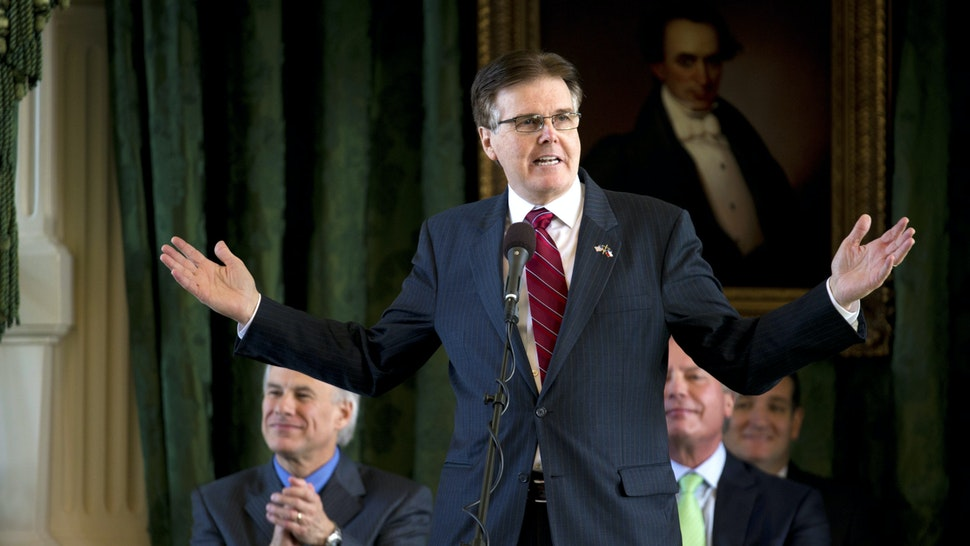 Sen. Dan Patrick of Houston speaks in the Texas Senate chamber where he will take over as Lt. Governor of Texas on January 12, 2015 as incoming Governor Greg Abbott listens during AG transition ceremonies in early January. Abbott becomes Texas' 49th Governor on January 20, 2015.