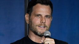 Politcal commentator, comedian and television personality Dave Rubin performs during his appearance at The Ice House Comedy Club on March 8, 2019 in Pasadena, California. (Photo by Michael S. Schwartz/Getty Images)