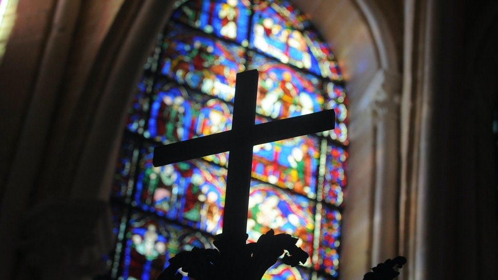 View taken on August 26, 2009 shows a cross and a stained glass in one of the restored chapels of the Cathedral of Chartres, 90 kilometers (55 miles) southwest of Paris.