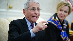 Dr. Anthony Fauci (L), director of the National Institute of Allergy and Infectious Diseases speaks next to Response coordinator for White House Coronavirus Task Force Deborah Birx, during a meeting with US President Donald Trump and Louisiana Governor John Bel Edwards D-LA in the Oval Office of the White House in Washington, DC on April 29, 2020.