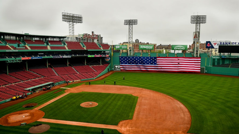 BOSTON, MA - MAY 25: The American flag is dropped over the Green Monster on Memorial Day as the Major League Baseball season is postponed due to the coronavirus pandemic on May 25, 2020 at Fenway Park in Boston, Massachusetts. (Photo by Billie Weiss/Boston Red Sox/Getty Images)