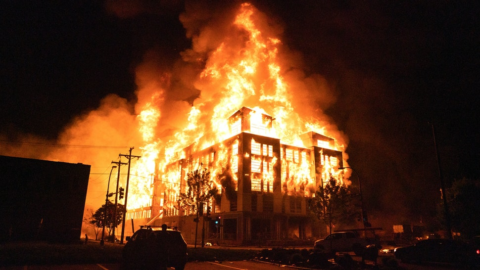 MINNEAPOLIS, MN - MAY 27: Rioters set fire to a multi-story affordable housing complex under construction near the Third Precinct, spreading the blaze to surrounding homes. Protester and police clashed violently in South Minneapolis as looters attacked business on Lake Street on Wednesday, May 27, 2020 in Minneapolis. The protests were sparked by the death of George Floyd at the hands of a Minneapolis Police officer Monday.