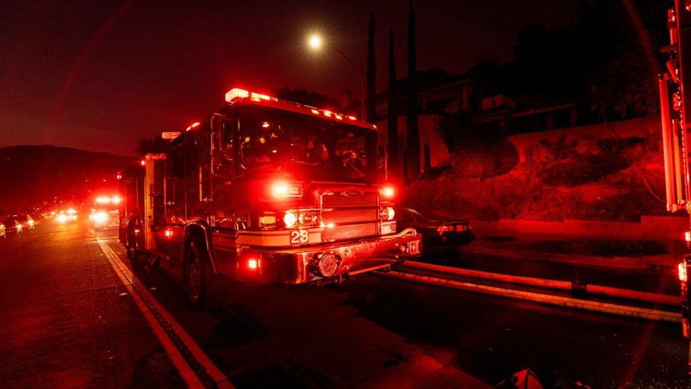 Firetrucks seen during a wildfire in Glendale near Los Angeles, California on August 25, 2019.
