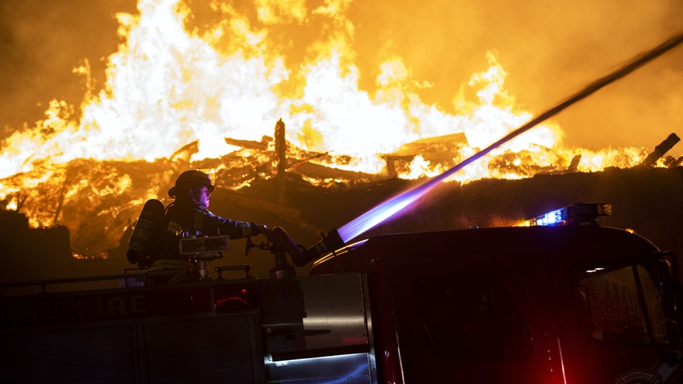 "MINNEAPOLIS, MN - MAY 27: Fire fighters work to put out a fire at a factory near the Third Police Precinct on May 27, 2020 in Minneapolis, Minnesota. A number of businesses and homes were damaged as the area has become the site of an ongoing protest after the police killing of George Floyd. Four Minneapolis police officers have been fired after a video taken by a bystander was posted on social media showing Floyd's neck being pinned to the ground by an officer as he repeatedly said, ""I can't breathe"". Floyd was later pronounced dead while in police custody after being transported to Hennepin County Medical Center."