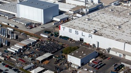 The Tesla Inc. assembly plant stands in this aerial photograph taken above Fremont, California, U.S., on Wednesday, Oct. 23, 2019. Tesla shares are trading above Wall Street expectations after spending most of the year languishing below analysts' average price targets.
