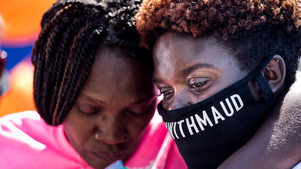 BRUNSWICK, GA - MAY 09: Jasmine Arbery, sister of Ahmaud Arbery (R) and Wanda Cooper-Jones, Ahmaud's mother, comfort one another while people gather to honor Ahmaud at Sidney Lanier Park on May 9, 2020 in Brunswick, Georgia. Arbery was shot and killed while jogging in the nearby Satilla Shores neighborhood on February 23.