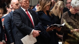 US President Donald Trump and First Lady Melania Trump attend a Christmas Eve service at Washington National Cathedral in Washington, DC, on December 24, 2018.