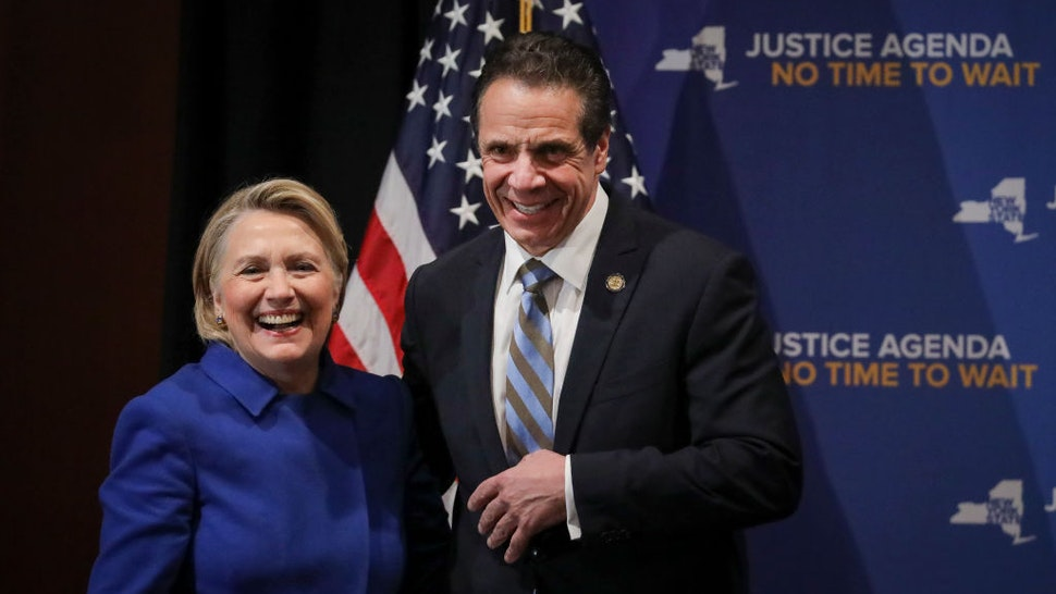 Former Secretary of State Hillary Clinton and New York Governor Andrew Cuomo smile at the end of an event to discuss reproductive rights at Barnard College, January 7, 2019 in New York City.