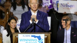 Former vice president Joe Biden takes a moment as fans cheer when a supporter shouts that Biden should run for president in 2020,