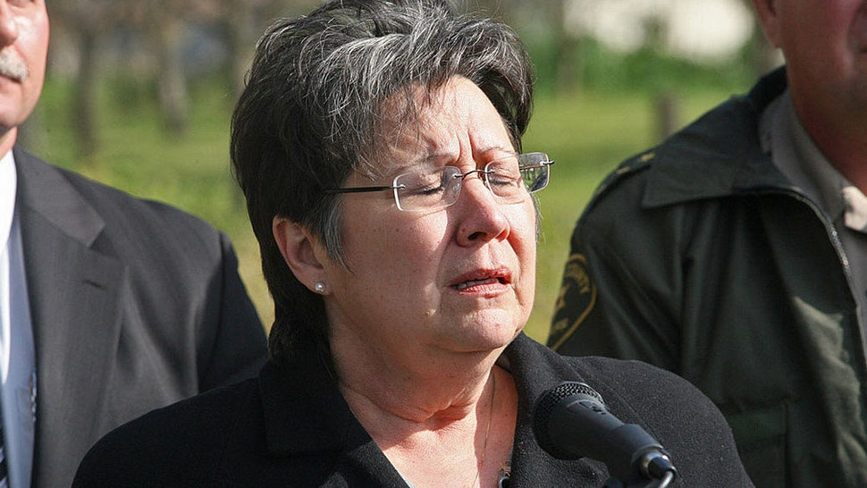 Fresno County Sheriff Margaret Mims (middle) closes her eyes during an emotional news conference concerning an ongoing standoff near Minkler, California, on Thursday, February 25, 2010.