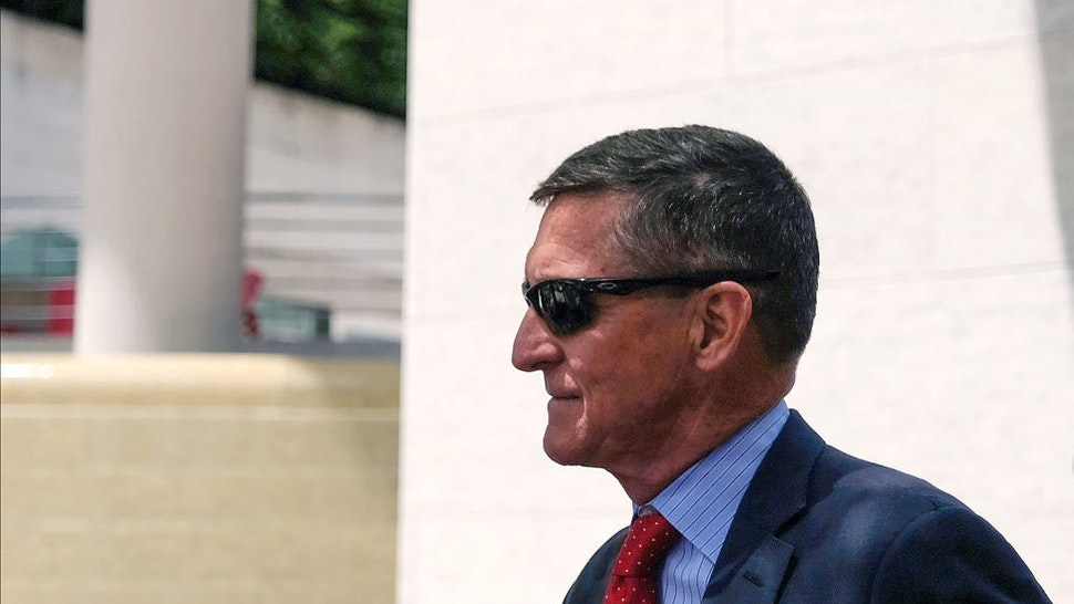 President Donald Trump's former National Security Adviser Michael Flynn leaves the E. Barrett Prettyman U.S. Courthouse on June 24, 2019 in Washington, DC. Criminal sentencing for Flynn will be on hold for at least another two months.
