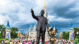 ORLANDO, FLORIDA, UNITED STATES - 2019/07/17: Walt Disney and Mickey Mouse statue inside of the Magic Kingdom theme park . The Cinderella castle can be seen in the background. (Photo by Roberto Machado Noa/LightRocket via Getty Images)