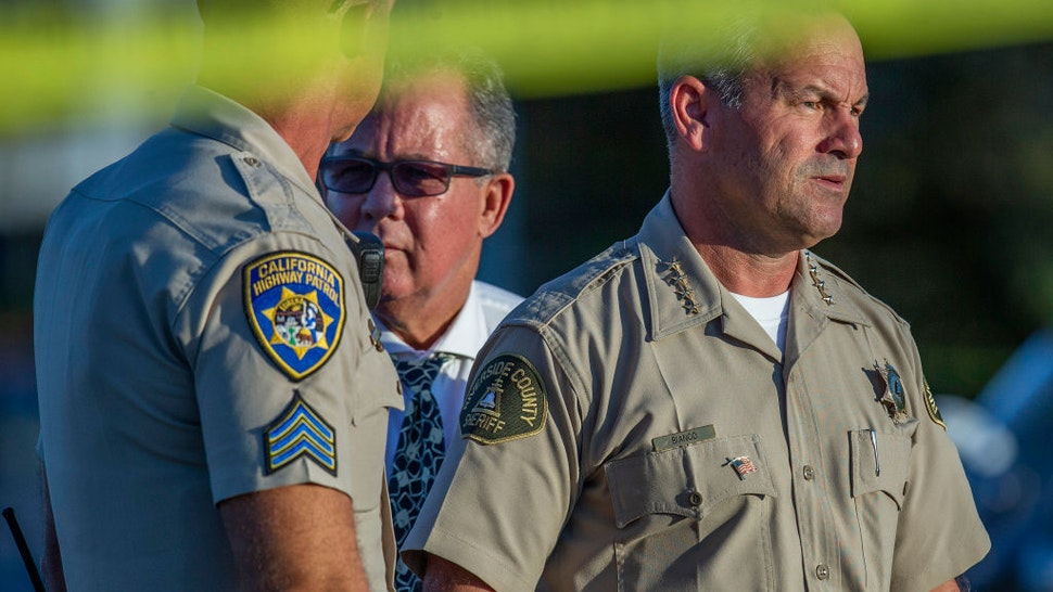 Riverside County Sheriff Chad Bianco, right with Riverside City Police Chief Sergio G. Diaz and a CHP officer