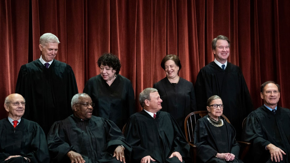 Justices of the United States Supreme Court sit for their official group photo at the Supreme Court on Friday, Nov. 30, 2018 in Washington, DC.