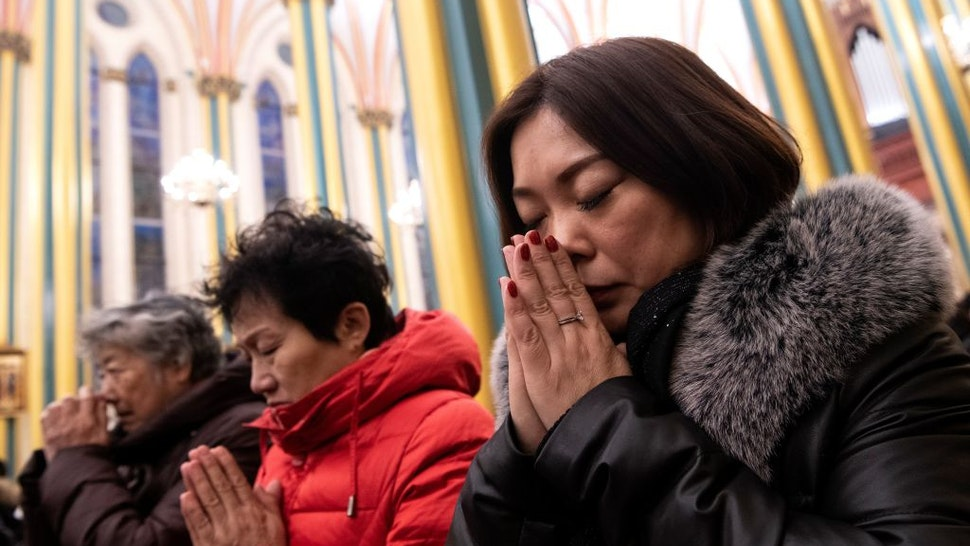 Worshippers attend a Christmas eve mass at the Xishiku Cathedral in Beijing on December 24, 2019.